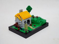 Puerto Desafio Blacksmith Shop (Robert4168/Garmadon) Tags: lego micro build blacksmith thatched roof green hills fence brown waterwheel eslandola brethrenofthebrickseas puerto desafio