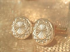 Debonair's LIGHT - MM - Theme-Buttons And Bows (LOVE.OVER.LUST.) Tags: mm macromondays bowsandbuttons buttonsandbows buttons cufflinks gold bokeh tabletop fashion accessories men sundaylights