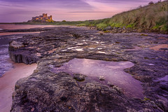 Bamburgh Castle at Sunset, Bamburgh, England. (Gary Alexander's Landscape Photography) Tags: bamburgh castle england sun sky scenery north canon 6d 2017 november 17 40 f4 l landscape lens land light location tripod travel thephotographyblog rock rocks sea sunset supershot lee hard grad angle absolutelystunningscapes atmosphere atmospheric art awesome colour color cloud clouds colourful colorful coast coastal pool photography photo