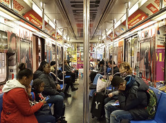 Divided commuters (Eddie Hales) Tags: subway nyc commuters train posters thebigapple