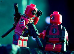 Like Father Like Son (jezbags) Tags: lego legos toy toys marvel macro macrophotography macrodreams macrolego canon60d canon 60d 100mm closeup upclose marvelstudios legomarvel deadpool kid farther son gun sword