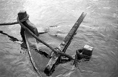 Drowning (literally) (Nikos.K.) Tags: 2017 ιχθυόσκαλα boat sunk damaged sea blackandwhite film 135 ilford panfplus expired homebrewdeveloper d76 olympusom2n zuiko 50mm18