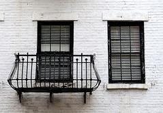 Black on white:  Christopher Street, Greenwich Village, New York (Spencer Means) Tags: architecture house apartment window balcony balcón balkon ironwork wroughtiron brick white blind blinds venetian christopher street greenwichvillage manhattan newyork city urban nyc ny dwwg