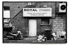 ROYAL FITNESS (StockCarPete) Tags: fitness bw brickwork sign london uk scooter rubbish brickedup window