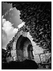 The Ruins of Kher Keep. (icarium82) Tags: bw canoneos7d monochrome travel archaeology bnwblackandwhiteblackwhitewhiteandblackwnbschwarzweis stones canonefs18135mmf3556is history crusade arab anisotropicdiffusion framed middleeast ruins clouds castle fortress keystonearch