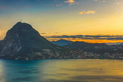 Amazing Sunset At The City & Lake Of Lugano - Switzerland (Cederquist Christoffer) Tags: waterlandscapetravelseaseashorebeachmountainskyscenicoceannatureislandoutdoorssunsetdaylightrocklakereflectionbaylakecityluganoswitzerlandeuropeticino