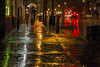 Rain & shine in green, amber and red. (Jacques Lebleu) Tags: night rain street red yellow black amber vehicules woman water