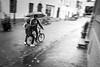 White 2 - Teamwork (DerHarlekin) Tags: fahrrad regen bicycle rain umbrella regenschirm temarbeit teamwork friends city stadt innenstadt altstadt fusgängerzone