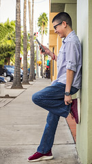 Communication is key (RaulCano82) Tags: son downtown harlingen harlingentx harlingentexas texas tx canon 80d raulcano photography rgv teen teenager palmtree shoes iphone xbox watch glasses candid technology tech communication