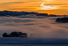 Fog eats house (tom.leuzi) Tags: canonef70200mmf4lisusm canoneos6d haus nebel schnee schweiz sonnenuntergang switzerland winter building cold cool dusk fog house kalt landscape mist snow sunset