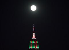The first supermoon of 2018 hovers over the Empire State Building. (apardavila) Tags: esb empirestatebuilding hoboken manhattan nyc newyorkcity moon sky skyline skyscraper supermoon