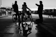 . (raffaella.rinaldi) Tags: monochrome people contrast gesture doisneau reflection bicycle out focus blackandwhite hand talking puddle 2018 newyear water silhouette shadows light italy winter bw flickrfam