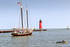 Red Witch Tall Ship with Lighthouse in Background - Kenosha, Wisconsin (Peter Ciro Photography) Tags: kenosha lighthouse redwitch sailingboat wisconsin geo:lat=42587938333333 geocountry camera:model=canoneos7dmarkii camera:make=canon exif:isospeed=100 geostate geocity geolocation geo:lon=87811003333333 exif:focallength=46mm exif:model=canoneos7dmarkii exif:aperture=ƒ16 exif:lens=2470mm exif:make=canon