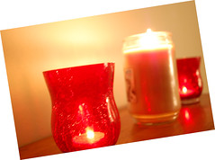 Illuminated Candles. (dccradio) Tags: lumberton nc northcarolina robesoncounty indoors inside candle candles burning illuminated flame redcandleholder candleholder tealightcandle jarcandle wall fire nikon d40 dslr tealight red light candlelight effect