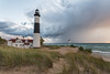 Passing Storms (Aaron Springer) Tags: michigan northernmichigan lakemichigan thegreatlakes bigsablepoint lighthouse stormclouds weather beach dune dunegrass outdoor landscape