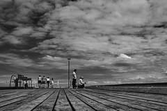 Merimbula's timber wharf (rvrossel) Tags: people nature day beach water sea sky light clouds wharf bw blackandwhite fujifilm fujixseries fujixpro2 fujixf23mmf2 fujishooters fujilove