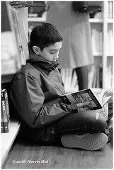 I Am Not Alone - Richmond Centre XT5247e (Harris Hui (in search of light)) Tags: harrishui fujixt1 digitalmirrorlesscamera fuji fujifilm vancouver richmond bc canada vancouverdslrshooter mirrorless fujixambassador xt1 fujixcamera fujixseries fujix fuji56mmf12 fujiprimelens fixedlens blackwhite digitalbw mono monochrome candid portrait streetphotography reading reader paperbookreader books bookstore shoppingmall youngreader concentration