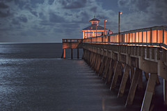 Deerfield Beach Pier Level View (hitmanfre1) Tags: miami deerfield pier light orange blue ocean wave waves cloud clouds night nightphotography nighttime moonlight florida southflorida south mood architecture nikon long exposure longexposure
