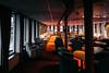 Slightly Tender (Thomas Listl) Tags: thomaslistl color budapest hungary hotel boat chairs armchairs tables floor ceiling orange warm mood windows lounge bar wideangle 24mm