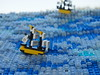 The End of the White Doubloon (Robert4168/Garmadon) Tags: lego ship brethrenofthebrickseas eslandola mardier bobs micro telescope water sea ocean waves ripples