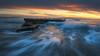 Winter Heat Wave (David Colombo Photography) Tags: ocean seascape sunset swamis wave pacific landscape color vibrant orange blue yellow motion nikon d800 davidcolombo davidcolombophotography outdoor sky clouds sea beach