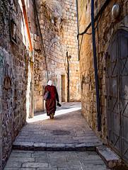 Jerusalem Take-Away (Trouvaille Blue) Tags: israel jerusalem alley woman stones walls overcoat light trouvailleblue carryout takeaway