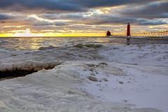 Grand Haven On Ice (matthewkaz) Tags: lake lakemichigan water greatlakes grandhavenlighthouse grandhvaen lighthouse pier ice snow sunset sky clouds michigan puremichigan 2016