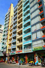 Colorful, narrow and tall buildings, Nha Trang, Vietnam (adamba100) Tags: asia asian china chinese korea korean mongolia mongolian vietnam vietnamese thai beijing town city view landscape cityscape street life lifestyle style people human person man men woman women male female girl boy child children kid interesting portrait innocent cute charm pretty beauty beautiful innocence play face headshot pure purity tourism sightseeing tourist travel trip light color colour outdoor traditional cambodia cambodian phnom penh sony a6300 18105 siem reap pattaya bangkok architecture bike road building