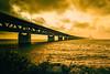 Not the Golden Gate, just the Öresund bridge and a burning sky (Maria Eklind) Tags: malmöoutdoor öresund bridge malmö architecture water burning sky sweden öresundsbron himmel bro sea skånelän sverige se sunset grass