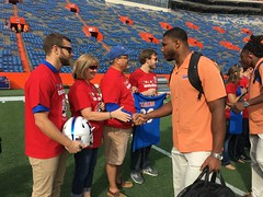 2016_T4T_University of Florida 118 (TAPSOrg) Tags: taps tragedyassistanceprogramsforsurvivors teams4taps gainesville florida universityofflorida football collegefootball salutingthosewhoserve survivors 2016 military outdoor horizontal redshirt footballfield group family player handshake candid males woman