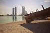 Two worlds (Jorgepevet) Tags: abudhabi boat skyline beach