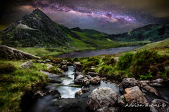Tryfan by Starlight (Adrian Evans Photography) Tags: llynogwen ogwenlake idwal digitalart tryfanmountain riverside ogwenvalley wales starlight 2017 waterfall uk northwales tryfan sky nightscape may galaxy cwmidwal landscape snowdonianationalpark landmark stream outdoor rocks rapids river adrianevans welshlandscape ogwen milkyway skyscape stars lake snowdonia mountain