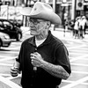 London cowboy (Peter du Gardijn) Tags: london londen londres gb greatbritain streetphotography streetportrait blackwhite hat cigarettes lighter man cowboy glasses