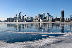 Toronto harbour turned a massive skating rink! (Can Pac Swire) Tags: toronto canada canadian city harbour harbor frozen polar vortex deep freeze weather solid lake water ice icy cold very extremely winter wintry sun sunny 2017aimg7110 polson street jenniferkaterynakovalskyj park