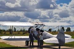 Boeing Stearman A75N1 N2S-4 Kaydet, 1942, C-FOXU - Guelph Airpark, Ontario.. (edk7) Tags: nikond610 nikonafnikkor80200mmf4556d edk7 2016 canada ontario guelph guelphairport cnc4 guelphairpark aerodrome tigerboysaeroplaneworksflyingmuseum annualairday2016 boeingstearmana75n1n2s4kaydet cn756467 1942 cfoxu classic vintage biplane aircraft plane airplane aviation passenger civilian civil private generalaviation worldwartwo wwii worldwar2 secondworldwar warbird postwar militarytrainer sky cloud grass tree people person male female rural country countryside field
