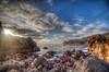 Sun Glinting Through Rockscape (Michael F. Nyiri) Tags: pelicancove palosverdespeninsulacalifornia southerncalifornia ocean pacificocean rocks rockyshore clouds sunset