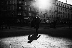 Smoking Man 117.365 (ewitsoe) Tags: smoke smokingman man walking shadows winter canon 50mm street urban city cityscape shadowsewitsoe eos6dii poznan poland polska emerge from shade light sun sunny