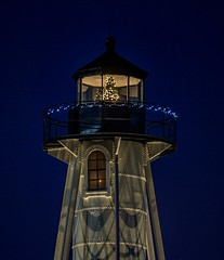 The Boca Grande Rear Entrance Lighthouse. After taking a few shots I noticed the Christmas tree in the top and then focused on it. Been really busy with life and hopefully I can find the time to get back at it here with my Flicker friends :) (wiltsepix) Tags: boca grande rear entrance lighthouse gasparilla florida