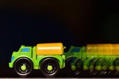 Toy Truck Trail Multi-exposure Macro (Zahidur Rahman ( Will be back soon )) Tags: macro macromondays doubleexposure multipleexposure truck trail toy t wheel plastic shape collectibles motion green black yellow contrast closeup details kids game vehicle new blue bright fade brighttofade 9shots dark inside indoor blackbackground nopeople yongnuoproledvideolight yongnuo led light shot darkroom brighttoy fadedtrail theme exposure exposuretechnique road creative composition nikond810