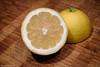 48 Juicy (manxmaid2000) Tags: lemon juice yellow fresh fruit juicy macro wood slice cut skin limon citrus taste healthy sour tart vitaminc flavour