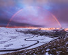 Winter rainbow at sunrise (John Finney) Tags: rainbow highpeak derbyshire peakdistrict edale twistyroad sunrise snow weather winter windchill snowbow