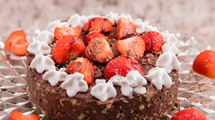 Chocolate cheesecake with strawberries and whipped cream. (annick vanderschelden) Tags: cake cooking pressurecooking dessert chocolate eggs butter ookiecrumbs creamcheese sugar flour sourcream food cakeholder glass stand cakestand strawberries whippedcream grated sauce belgium