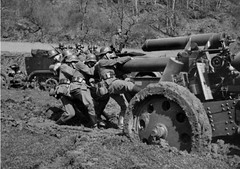 "German soldiers attempting to push a 15 cm sFH 18 150mm heavy howitzer • <a style=""font-size:0.8em;"" href=""http://www.flickr.com/photos/81723459@N04/25512669038/"" target=""_blank"">View on Flickr</a>"