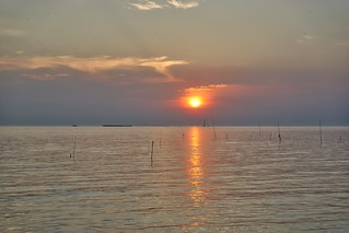 Sunset over the Gulf of Thailand seen from Rabieng Ta-Le seafood restaurant in Bang Pu district of Samut Phrakan province
