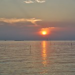 Sunset over the Gulf of Thailand seen from Rabieng Ta-Le seafood restaurant in Bang Pu district of Samut Phrakan province thumbnail
