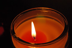 Candle Burning. (dccradio) Tags: lumberton nc northcarolina robesoncounty indoors inside candle candles burning illuminated flame jarcandle dark fire nikon d40 dslr tealight tealightcandle red light candlelight