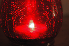 Tea Light Candle In A Red Candle Holder. (dccradio) Tags: lumberton nc northcarolina robesoncounty indoors inside candle candles burning illuminated flame redcandleholder candleholder tealightcandle fire nikon d40 dslr tealight red light candlelight