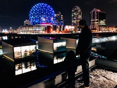 Day after Christmas (jlee31180) Tags: dec262017 vancouver night iphone8 candid reflection telusworld manandchild afterdark boxingday falsecreek olympicvillage