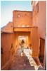 Woman, Aït-ben-Haddou, Morocco (Bigmob Dontwannastop) Tags: woman morocco moroccan back figure backlight hut mud village ait ben haddou sun wall house home tradition african