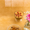Rice puddings desserts. (annick vanderschelden) Tags: ricepudding brownish yellow cornstarch granola cranberry spoon glass bowl gerbera goji wood lighteffect dessert raisin chia oatflakes sunflowerseeds maplesyrup rapeseedoil milletflakespumpkinseeds cashewnuts quinoa linseed puffedamaranth belgium